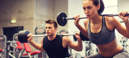 People in a gym exercising with weights
