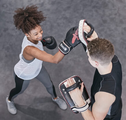 2 people exercising with punch pads